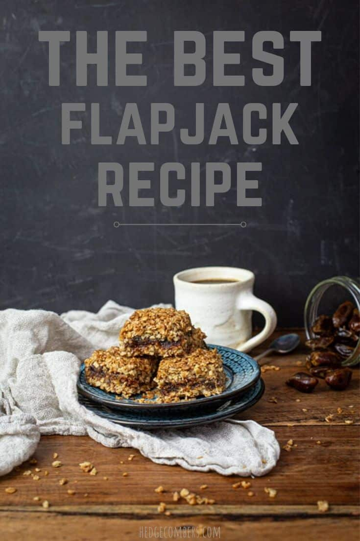 Flapjacks on plates with cup of coffee and spilt dates on table and the words The Best Flapjack Recipe on the background