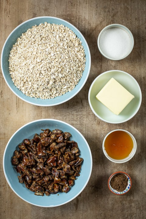 Bowls of ingredients for how to make the best flapjacks ever: includes oats, dates, butter, sugar, syrup and spice
