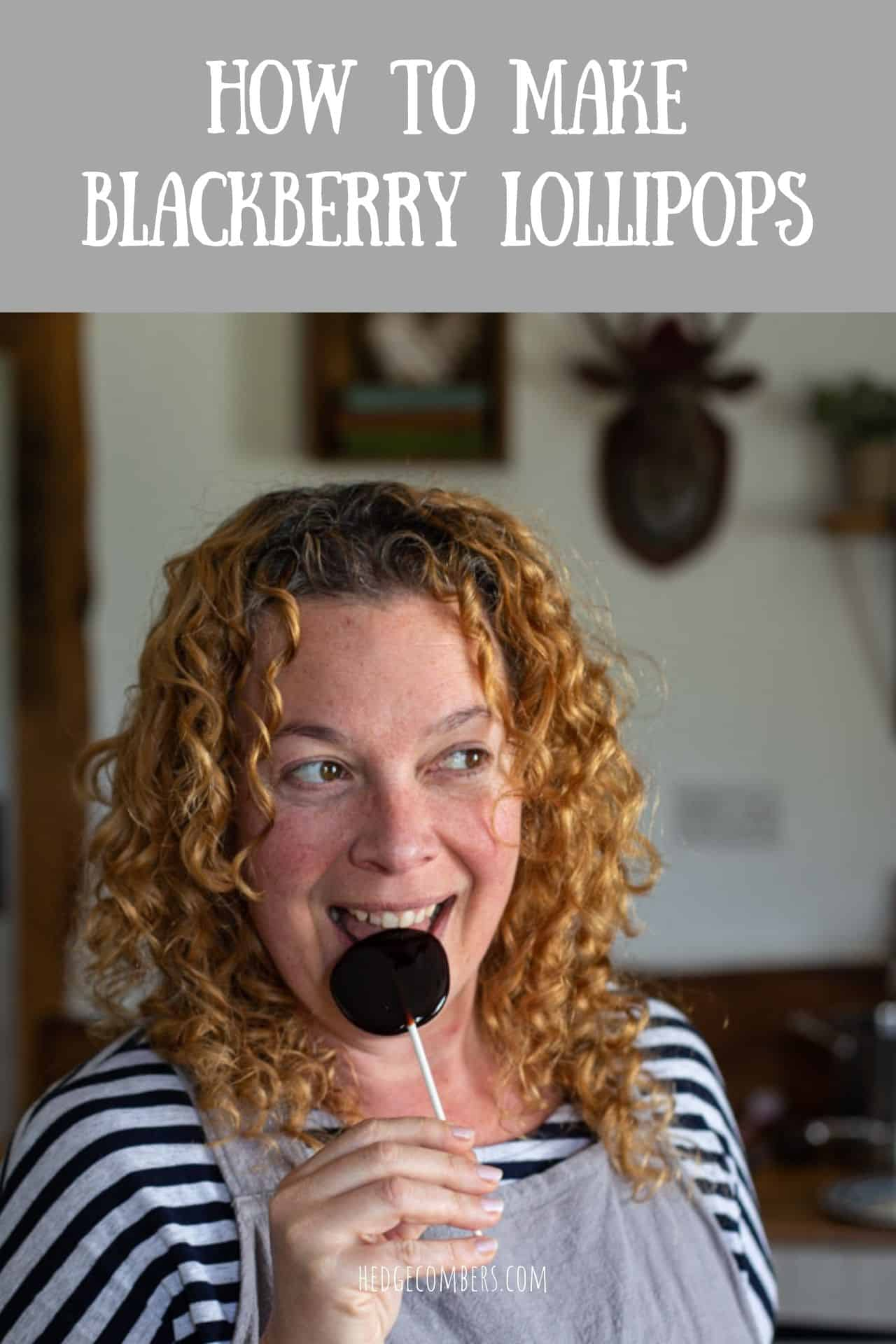 woman with red curly hair eating a homemade blackberry lollipop