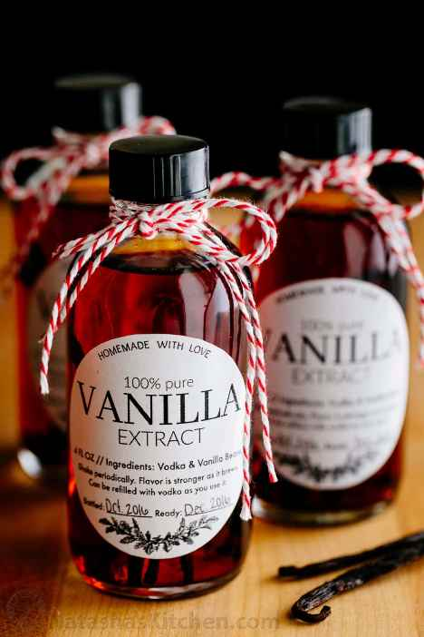 Sweet festive bottles of homemade vanilla extract with red and white string