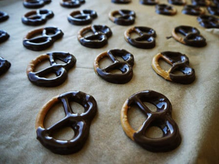 Pretzels with dark chocolate on a piece of brown baking paper, one of my 25 Homemade Christmas Gift Ideas