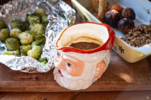 Christmas dinner leftovers: Brussel sprouts, vegetables and gravy in a Father Christmas jug