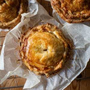 Three baked turkey leftovers pies in baking paper
