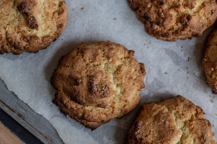 freshly baked coconut rock cakes on a baking sheet