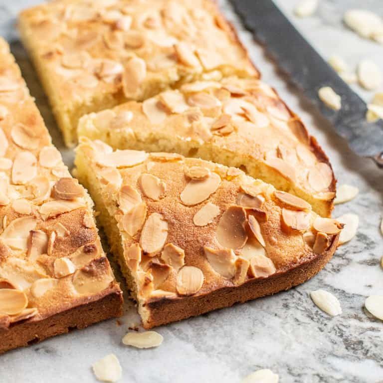 freshly baked almond slice on marble surface