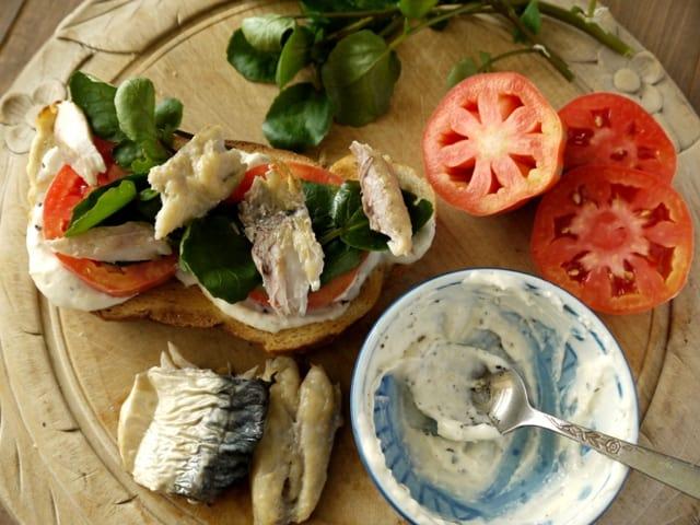 Smoked Mackerel Open Sandwich with Horseradish Mayo on a serving board