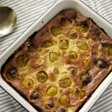 enamel dish of plum and cardamom clafoutis