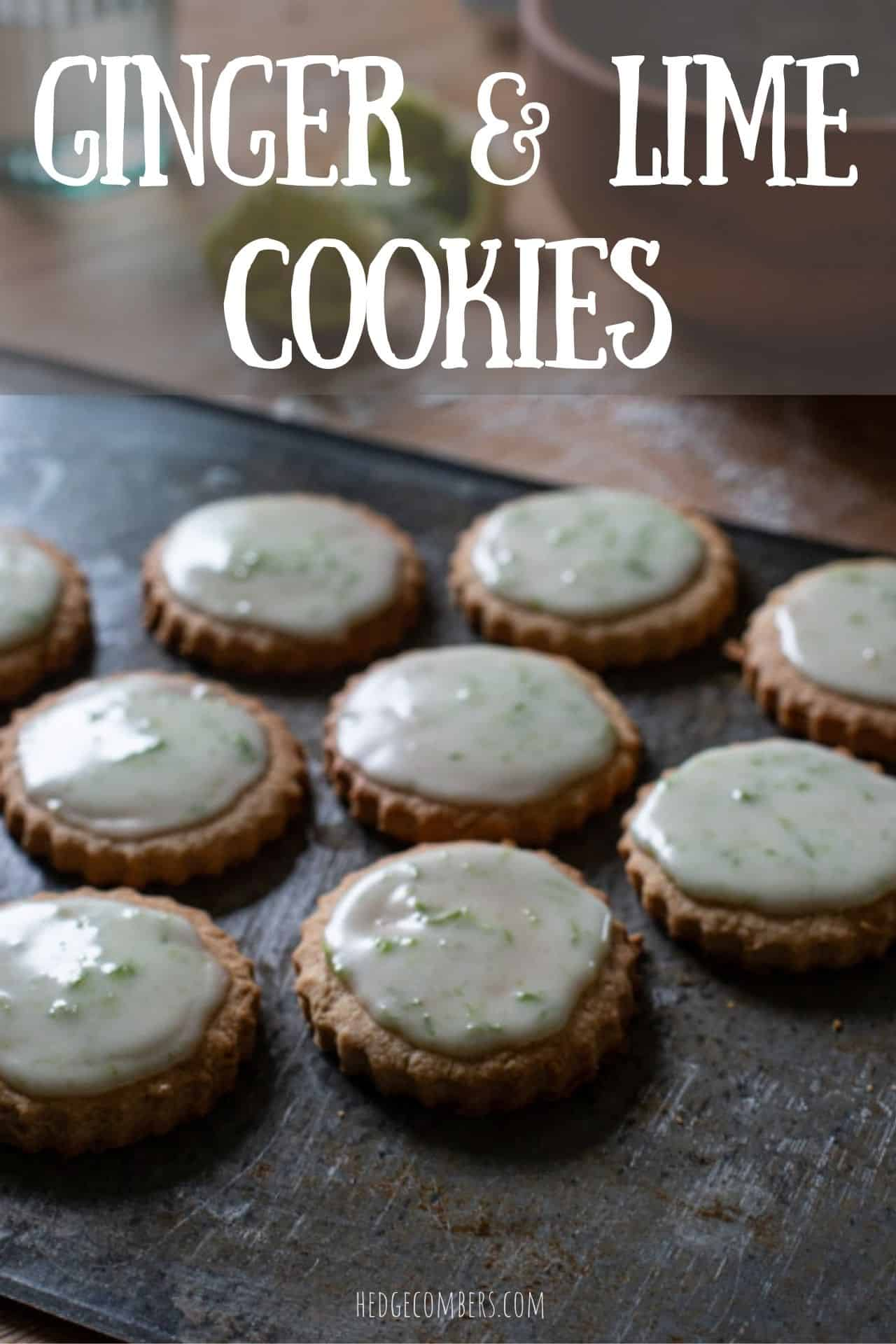 dark grey baking sheet topped with several iced ginger cookies on a wooden counter