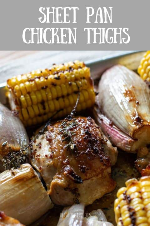 crispy baked chicken thigh in a white baking tin with corn and shallots
