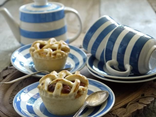 Mini Lattice Apple Pies on blue and white plates with matching cups,saucers and a teapot