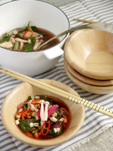 Japanese Style Chicken and Shimeji Mushroom Soup in bowls with chopsticks on a stripedcloth