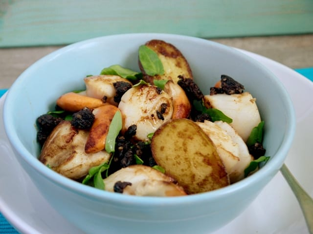 Scallops, New Potatoes and Black Pudding in a white bowl