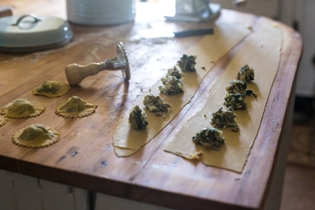Making Nettle and Feta Ravioli on a wooden kitchen top