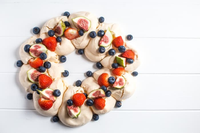 Meringue Wreath with fresh berries and figs on white background, one of my 25 Homemade Christmas Gift Ideas