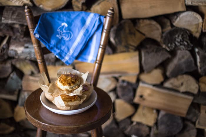 Chilli Beef Pies on a white plate with a blue cloth on a wooden chair