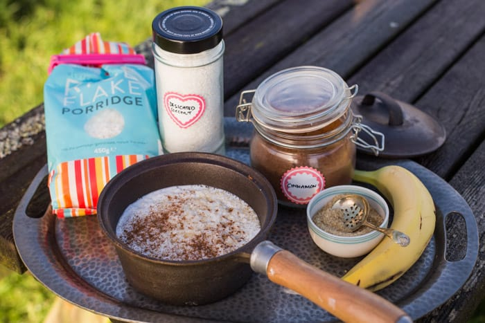 Gluten free camping breakfast -Coconut Rice Pudding ingredients on a metal tray on a wooden table