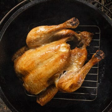 golden roast chicken in a dutch oven