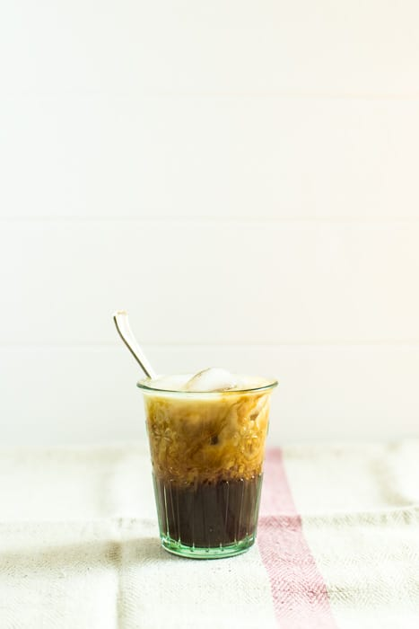 Easy Iced Coffee in a glass with a sppon on a pink and white check cloth