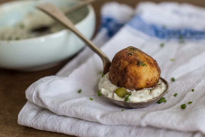 Crispy Fish Balls with Easy Tartare Sauce served on a teaspoon on a white cloth