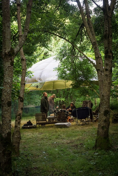 Eating under a parachute in the woods