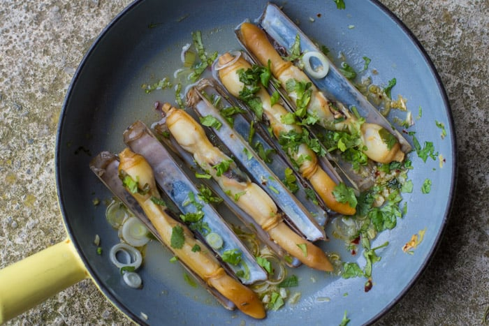 Asian Style Razor Clams in a blue pan
