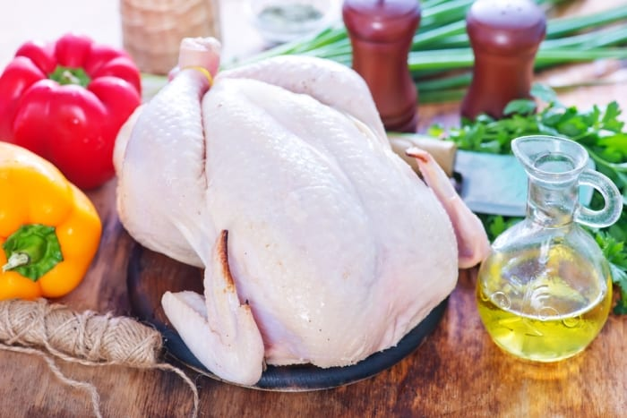 How to Safely Cook Turkey Turkey on a kitchen table with peppers and oil