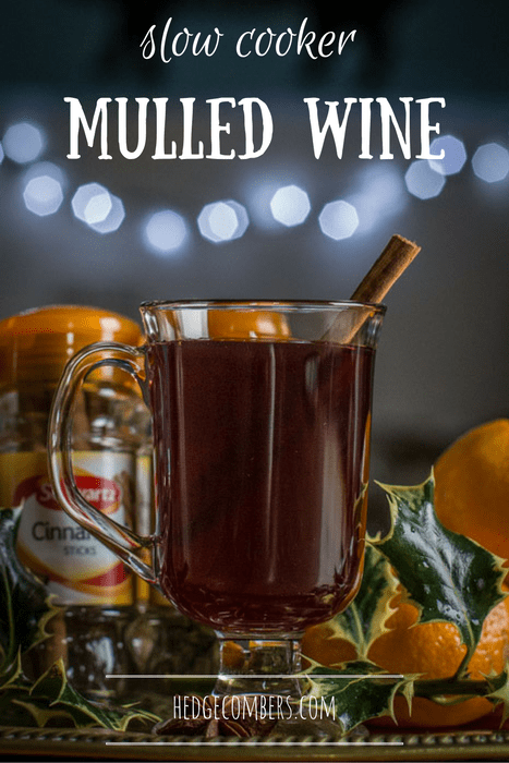 Glass of Slow Cooker Mulled Wine with cinnamon stick, one of my 25 Homemade Christmas Gift Ideas