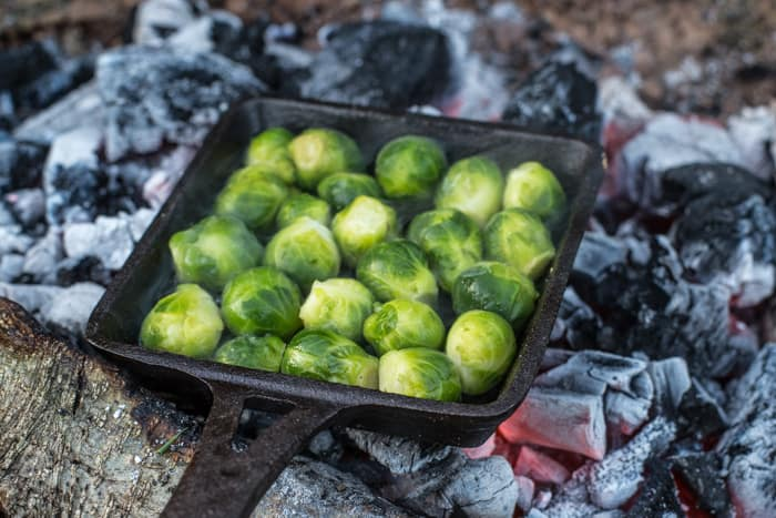 Brussels sprouts cooking on a campfire