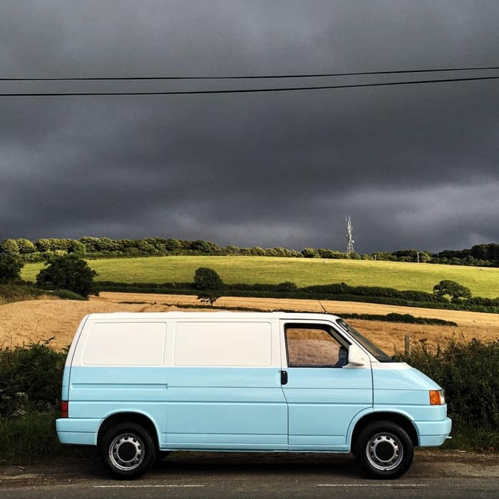 VW T4 after restoration with storm clouds behind