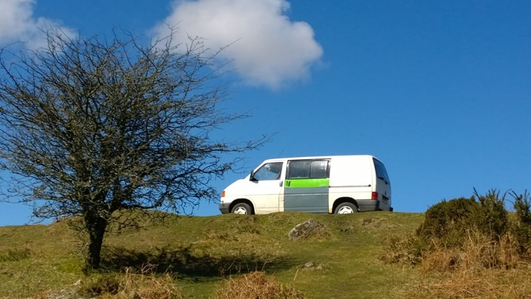 VW T4 before restoration against a deep blue Cornish sky