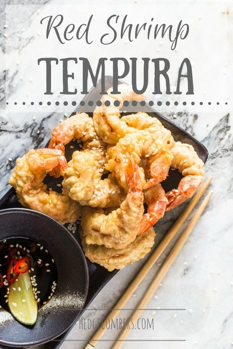 Red Shrimp Tempura with Spicy Soy Dipping Sauce on a serving dish with chopsticks on a marble board