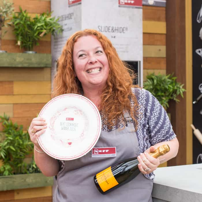 Jane (hedgecomber) Sarchet Neff Cookaholic Winner 2017, holding a bottle of champagne and winners plate