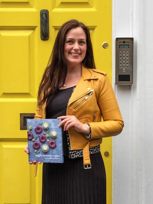 Katherine Hackworthy (aka Veggie Desserts) holding her debut cookbook