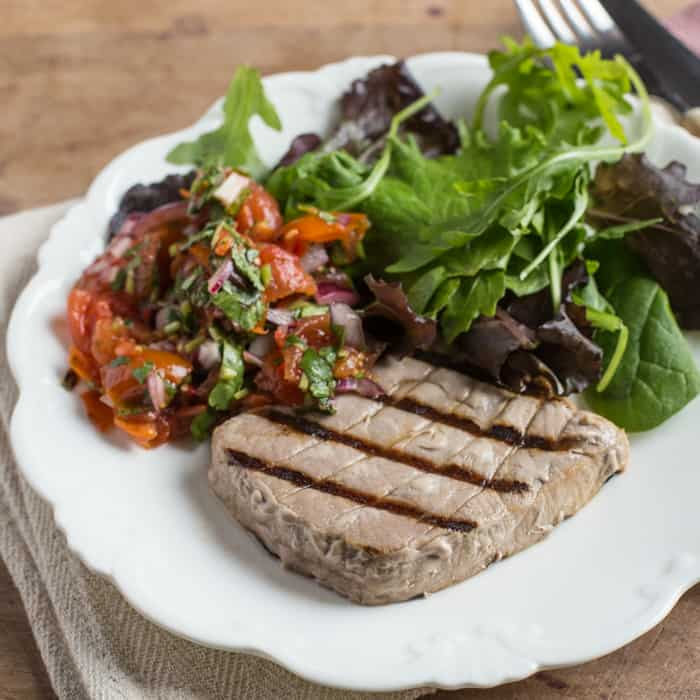 White plate with griddled tuna and salad