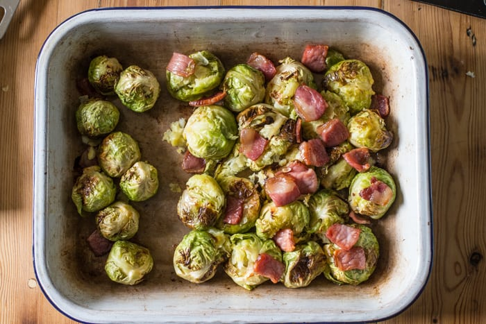 Smashing roast sprouts with bacon and chestnuts in a raosting tin