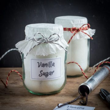 Pretty jars of homemade vanilla sugar to give as gifts