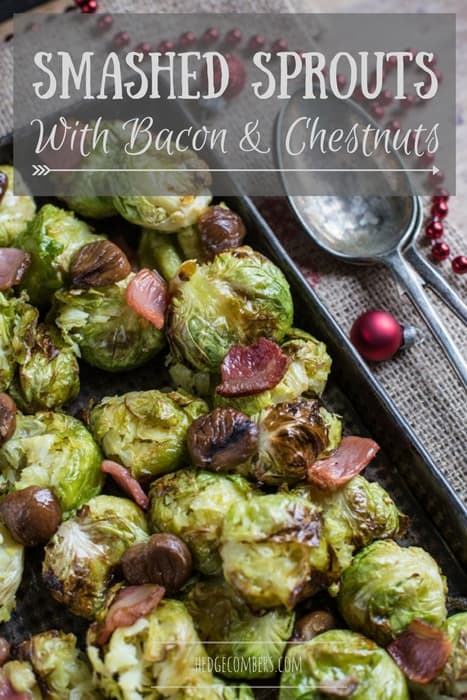 Smashed Sprouts with Bacon and Chestnuts in a roasting tin with a seving spoon beside them