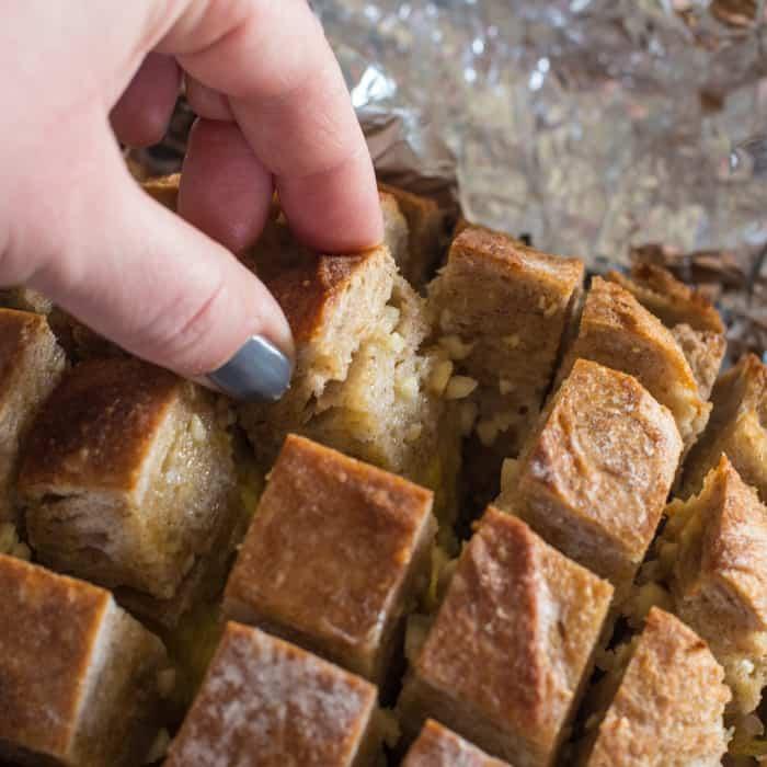 Pulling apart a loaf of Garlic Hedgehog Sourdough Bread