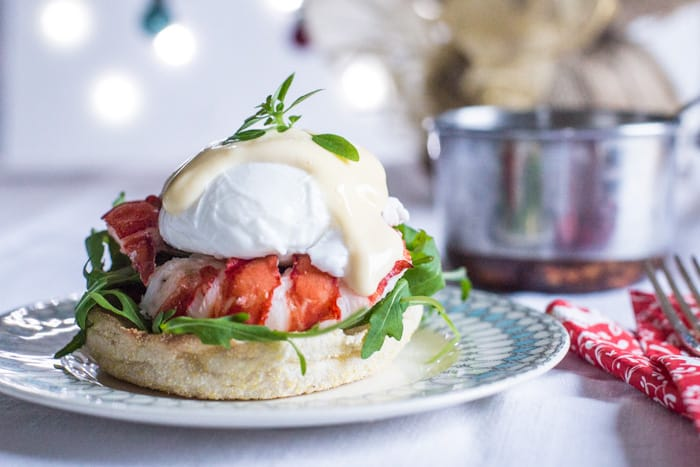 Lobster Eggs Benedict on china plate with christmas decorations