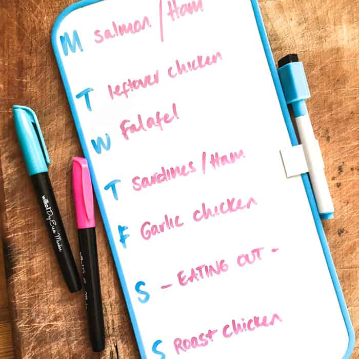 A small magnetic whiteboard that sticks to the fridge with days of the week and meal plans for each day