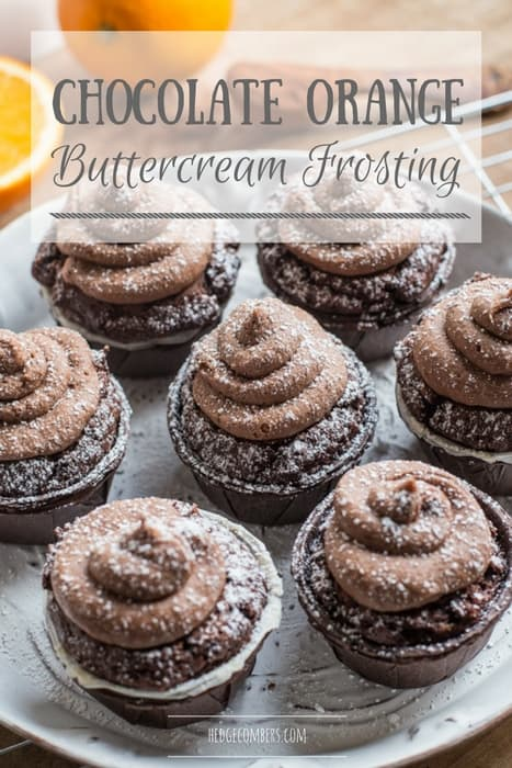 white plate with muffins and swirls of chocolate orange buttercream frosting