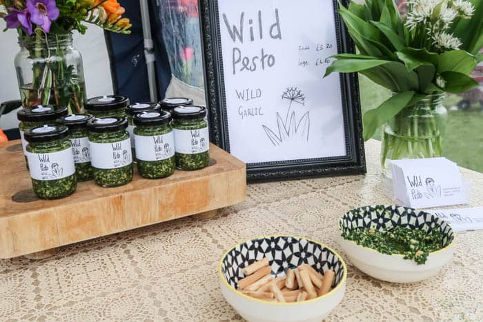 Table with jars of wild garlic pesto for sale