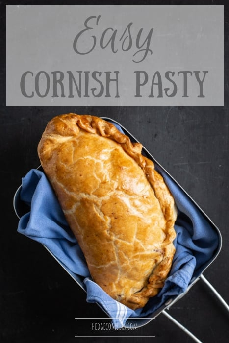 black background with blue cloth and golden Cornish pasty