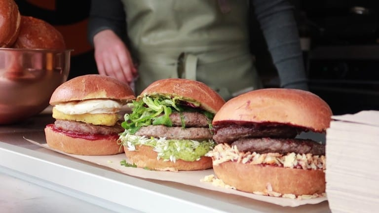 3 burgers lined up on a street food stall at the Porthleven Food Festival 2019