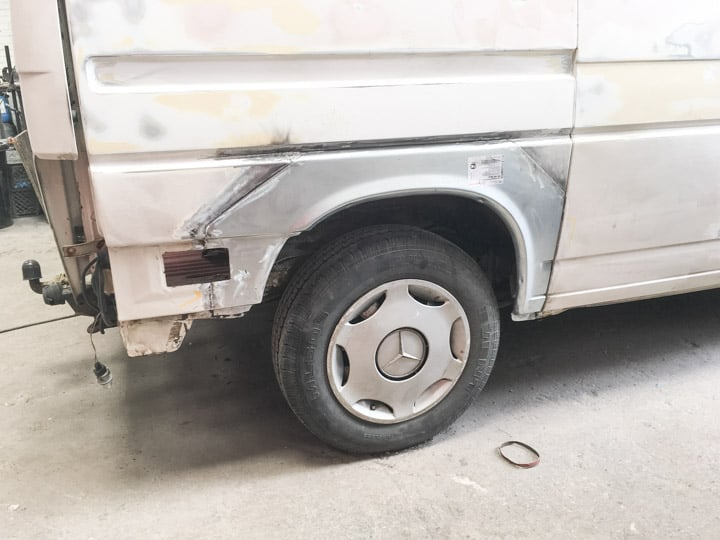 VW T4 white van with fresh wheel arches welded in