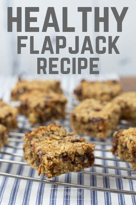 healthy flapjack squares on a metal cooling rack on top of stripey fabric
