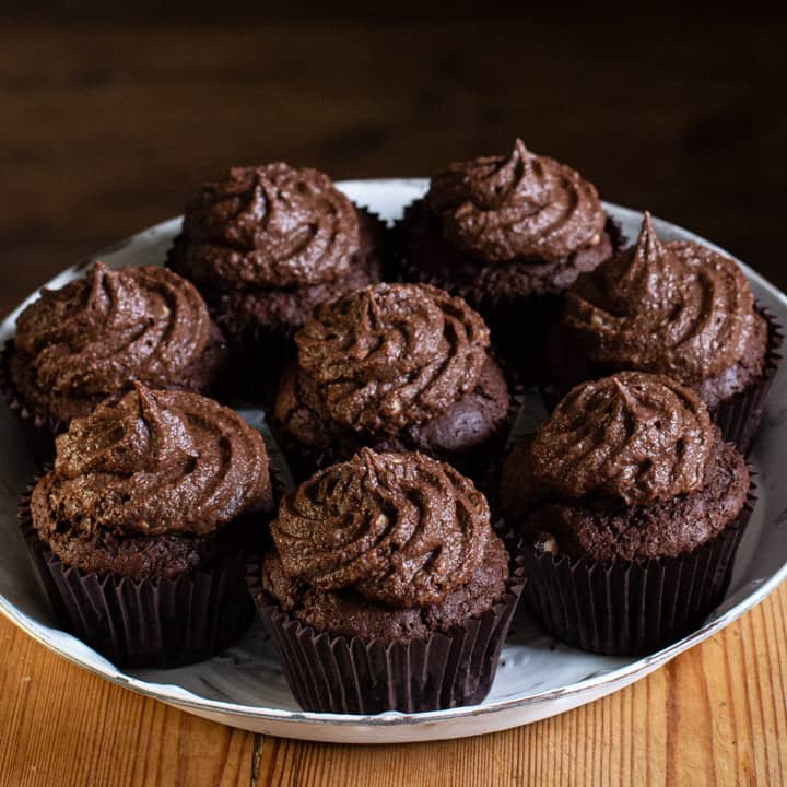 white plate of chocolate muffins