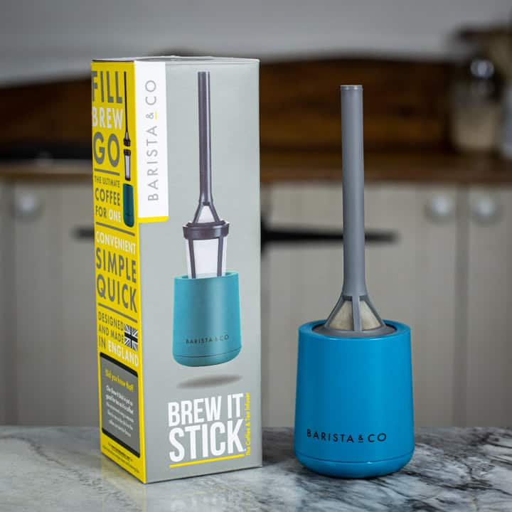 Brew It Stick camping coffee maker and its box on marble surface