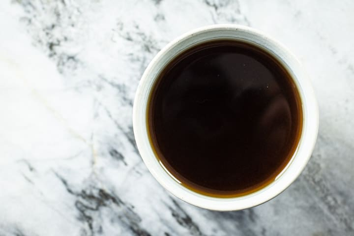 cup of black coffee on a marble surface