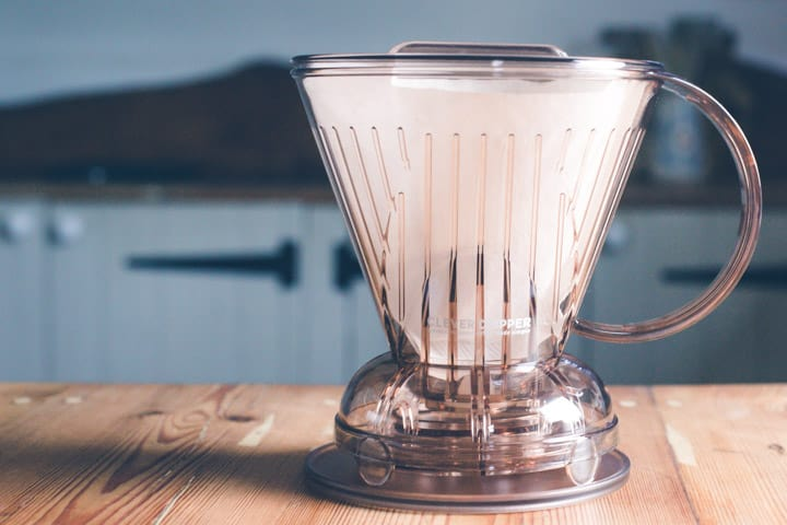 clever dripper coffee maker with paper filter on a wooden kitchen counter